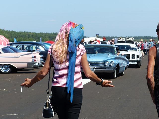 woman smoking near car
