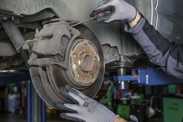 mechanic changing disc brakes