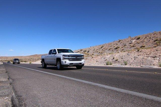 white chevrolet truck on highway