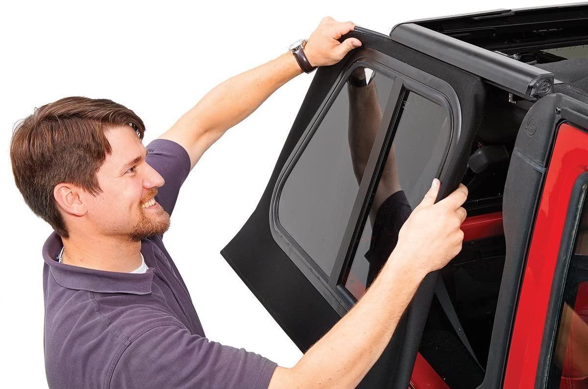 man installing jeep soft top window