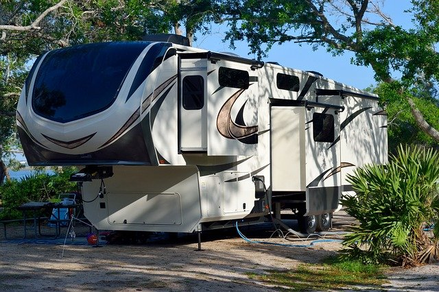 rv with fifth wheel trailer