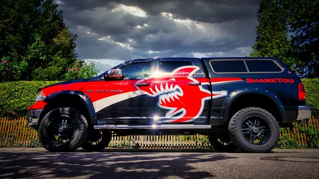 blue and red truck with a lift kit